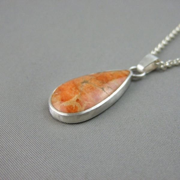 Orange Fossilised Apple Coral and Sterling Silver Pendant
