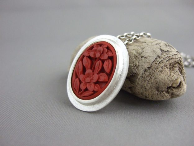 Carved Cinnabar and Sterling Silver Pendant